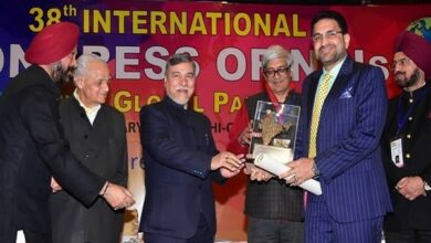 Photo of Mohammed Mansoor receiving award at 38th International Congress of NRI's