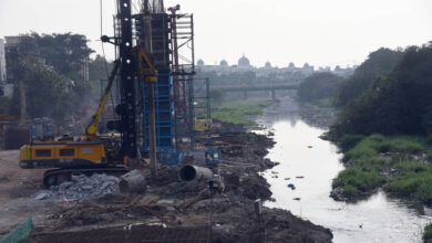 Photo of Metro Train work on the bed of Musi River