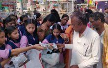 Distributing Food packets at Numaish Grounds Nampally