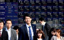 Japan's Nikkei slips at open as Dow's fall sours sentiment