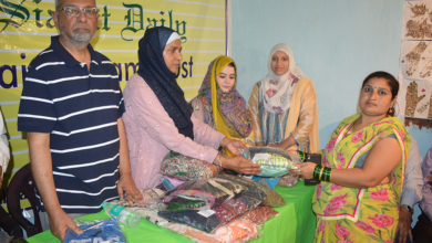 Photo of Faiz-e-Aam Trust, Helping Hand distribute clothes in Chandrayan Gutta