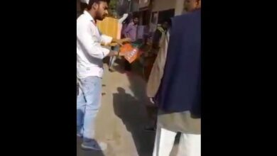 Photo of NSUI President tries to tear BJP's flag, held