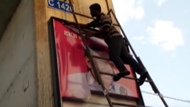 Photo of Ahead of General elections, GHMC staff removes all flex and banners