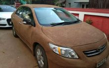 Woman covers car with cow dung to keep it cool