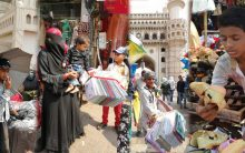 Poor children near Charminar helping people celebrate Eid