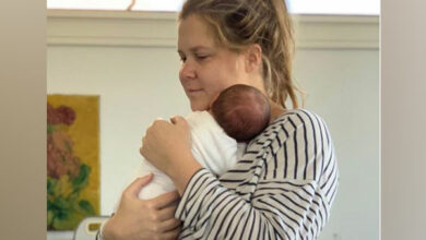 Photo of Amy Schumer posts picture of hubby Chrish Fischer giving son first bath