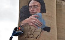 Another feather in NZ PM's cap; Australia unveils giant mural with image showing her hugging Muslim woman