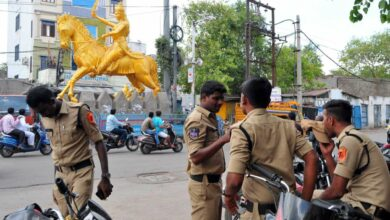 Photo of Security personnel stands near the statue of Rani Avanti Bai