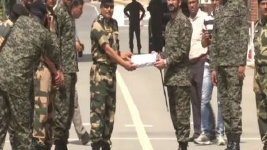 Photo of Personnel of BSF, Pakistan Rangers exchange sweets on the occasion of Eid