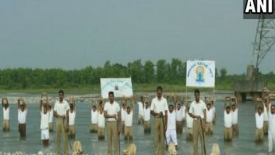 Photo of ITBP personnel perform yoga with dogs in tow