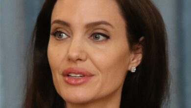 Photo of Angelina Jolie turns heads in striped dress at Paris