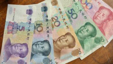 Photo of China's yuan strengthens against dollar