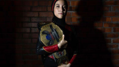 Photo of Hijab-wearing wrestler Nor Diana breaking barriers