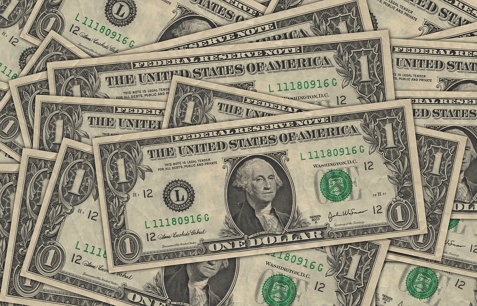 US dollar weakens amid downbeat data