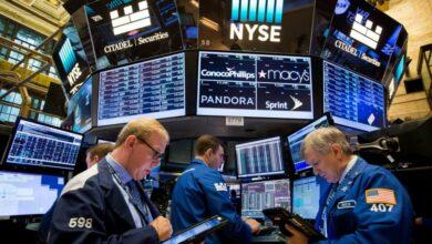 Photo of US stocks close mixed amid trade tensions, earnings