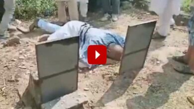 Photo of Man acquitted after 23 years in jail, cries at parents' graves