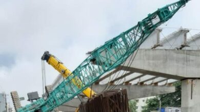 Photo of Crane tumbles down from Tolichowki bridge killing one; traffic advisory issued