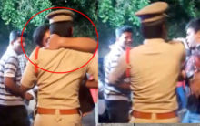 Police SI firmly spurns reveler's move to kiss him during Bonalu