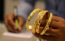Gold price touches new high