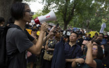 Hong Kong protesters walk tightrope between peace and violence