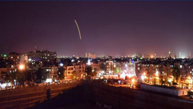Syrian state media broadcast footage of what it said were its air defences lighting up the night sky