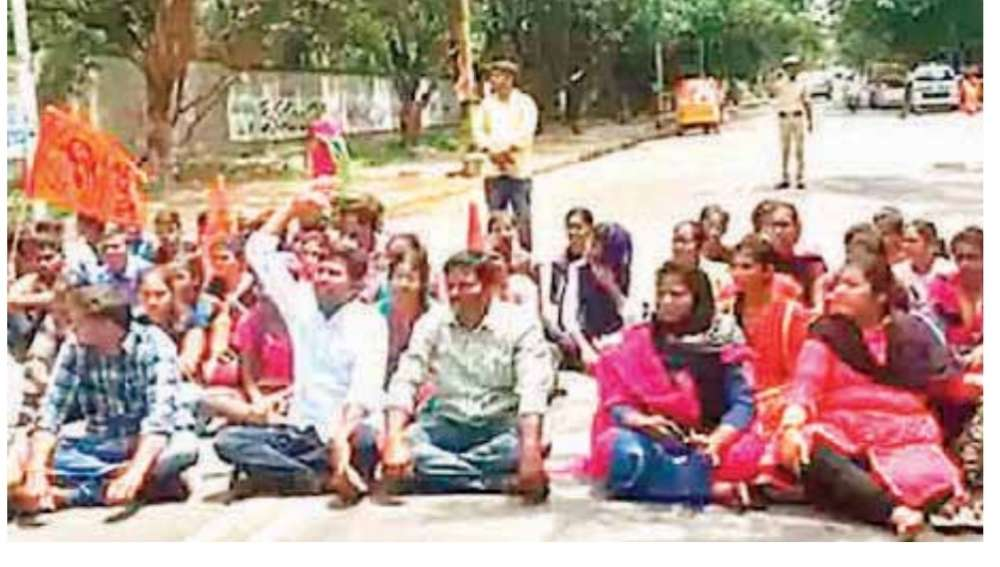 Osmania University hostel girls staged a dharna here on Friday