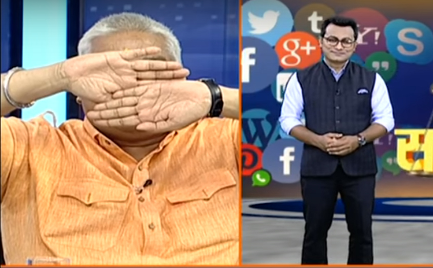 Ajay Gautam covers his eyes after seeing Muslim anchor