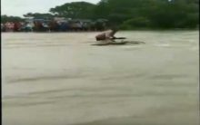 Man gets washed away while trying to cross overflowing bridge