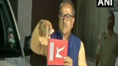 Photo of Former J-K Dy CM Nirmal Singh removes state flag from vehicle