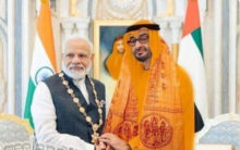 Abu Dhabi Crown Prince in saffron robes ?