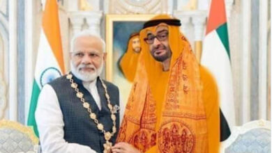 Photo of Abu Dhabi Crown Prince in saffron robes ?
