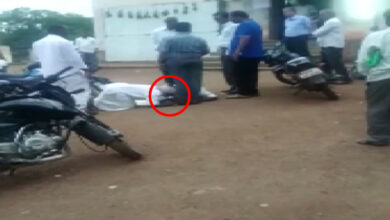 Photo of Two farmers seen touching feet of Revenue officer