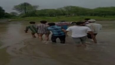 Photo of MP: Locals carry pregnant woman on cot amid heavy rainfall