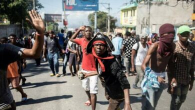 Photo of Two dead as hundreds of police, supporters march in Haiti