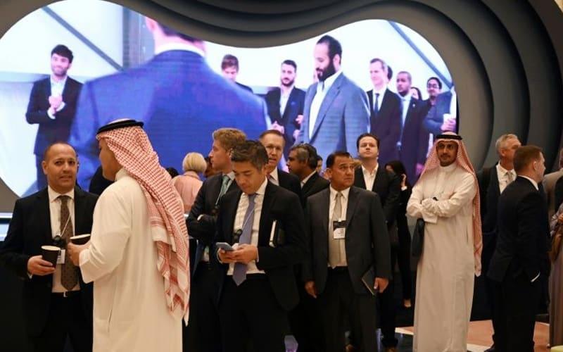 Saudi 'Davos in desert': Glitz, smiles, hidden name cards