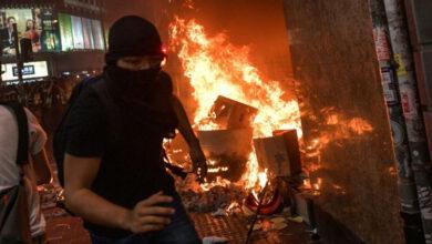 Photo of Hong Kong mask ban sparks violent clashes, rail shutdown