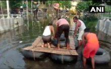 Bihar Floods: Locals construct makeshift boat to travel through streets