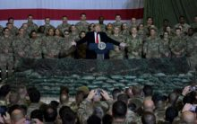 Trump visits troops in Afghanistan, says Taliban talks back on