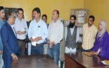J-K Assembly Speaker interacts with staff