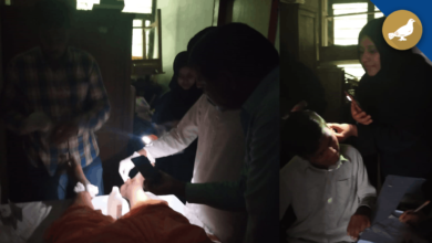 Photo of No Power, Doctor using a mobile flashlight to treat Patients