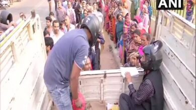 Photo of Patna: Cooperative employees sell onion wearing helmets