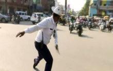 Traffic cop dances to manage traffic
