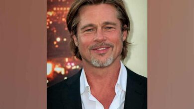 Photo of Brad Pitt wears name tag at Oscar nominees luncheon