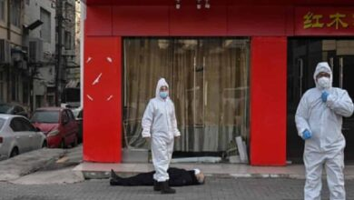 Photo of Lifeless body on empty Wuhan street witness to chilling reality