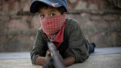 Photo of Mexican children take up arms in fight against drug gangs