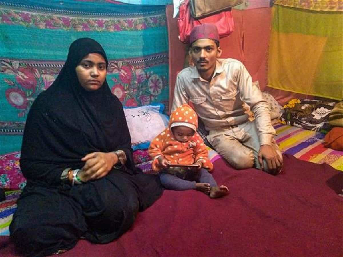 The infant's parents, Mohammed Arif and Nazia, at Shaheen Bagh area with their other child. (Photo: PTI)