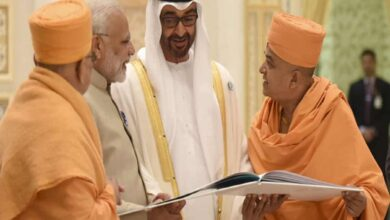 Crown Prince HH Mohamed bin Zayed al Nahyan and PM Narendra Modi are shown a book outlining the temple project Image Courtesy: BASP.Org