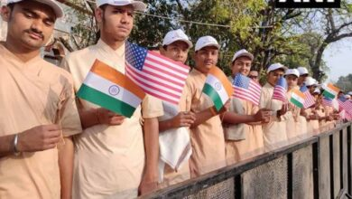 Photo of Students hold India. US flags to welcome Prez Trump in Ahmedabad