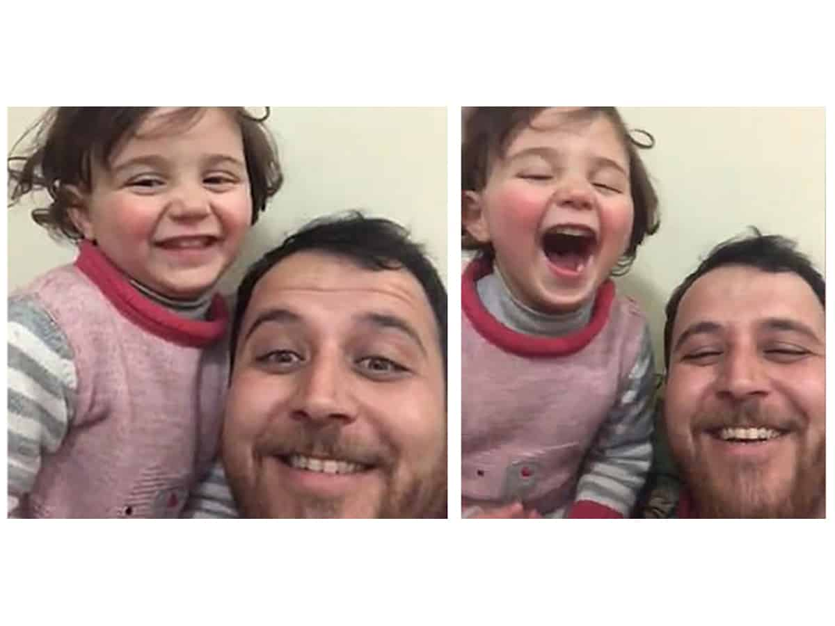 Syrian father teaches tiny daughter to laugh at bomb explosions