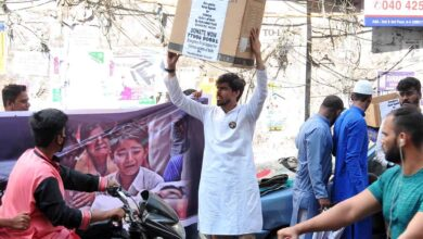 Photo of Young men collect donation for Delhi riot victims